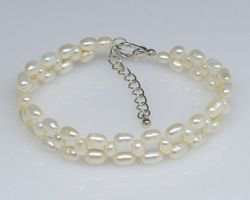 Bracelet en perle blanche/rose/lavande